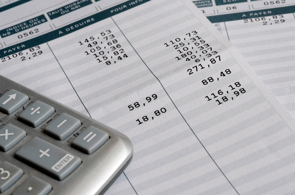 Euro,Pay,Slip,And,Calculator,,Close,Up,For,Payroll,Or